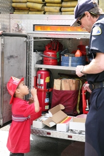 A Carnival 4 Kids guest checks out the Moraga Station 42's fire engine.