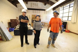 Brother President Ronald Gallagher, Gallery Director Carrie Brewster and OVERAA Construction foreman Walt Ross review gallery construction.