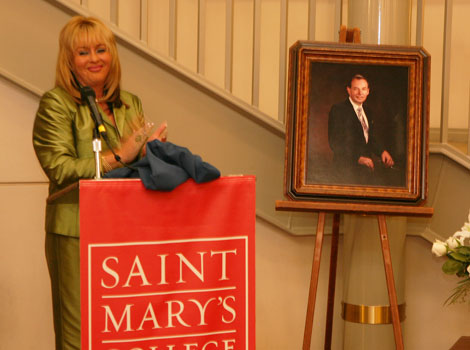 Linda Fitzpatrick, trustee for the Robert W. Summers estate, applauds unveiling of Summers' portrait