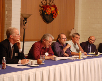 The Oct. 1 School of Economics and Business Administration panel included (from left) Roy Allen, Jack Rasmus, Andrew Williams, Asbjorn Moseidjord and Shyam Kamath. The event was sponsored by the Graduate Business Alumni Council.