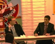 Scott Cullinane and Michael Antonopoulos present Republican arguments on Iraq during an April 8 campus debate.
