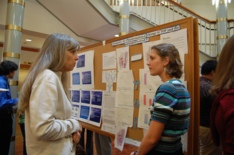 Lori Scognamillo (right) describes her summer science research project during the Oct. 3 presentation session in Brousseau Hall.